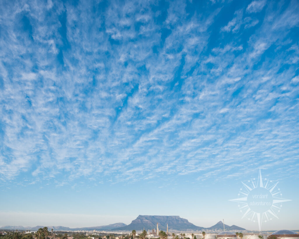 Blue skies and puffy clouds over Table Mountain in Cape Town, South Africa