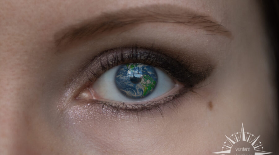 Ellie's eye with planet earth laid over her iris